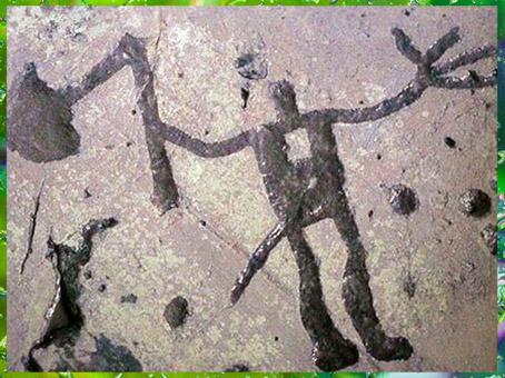 D'après un personnage ou une divinité armé d'une hache, art rupestre, Vastergötland, Suède, âge du Bronze. (Marsailly/Blogostelle)