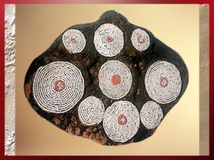 D'après les motifs spiralés d'un couvre-chef en relation avec l'initiation, Ouganda, art Africain. (Marsailly/Blogostelle)