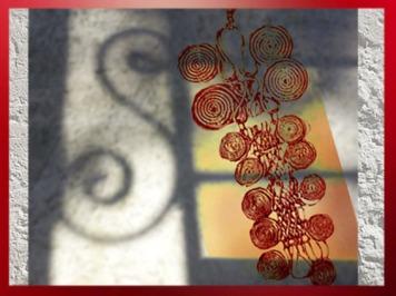 D'après les spirales d'un pendentif de la civilisation de Hallstatt, 750 avjc-450 avjc, premier âge du Fer. (Marsailly/Blogostelle)